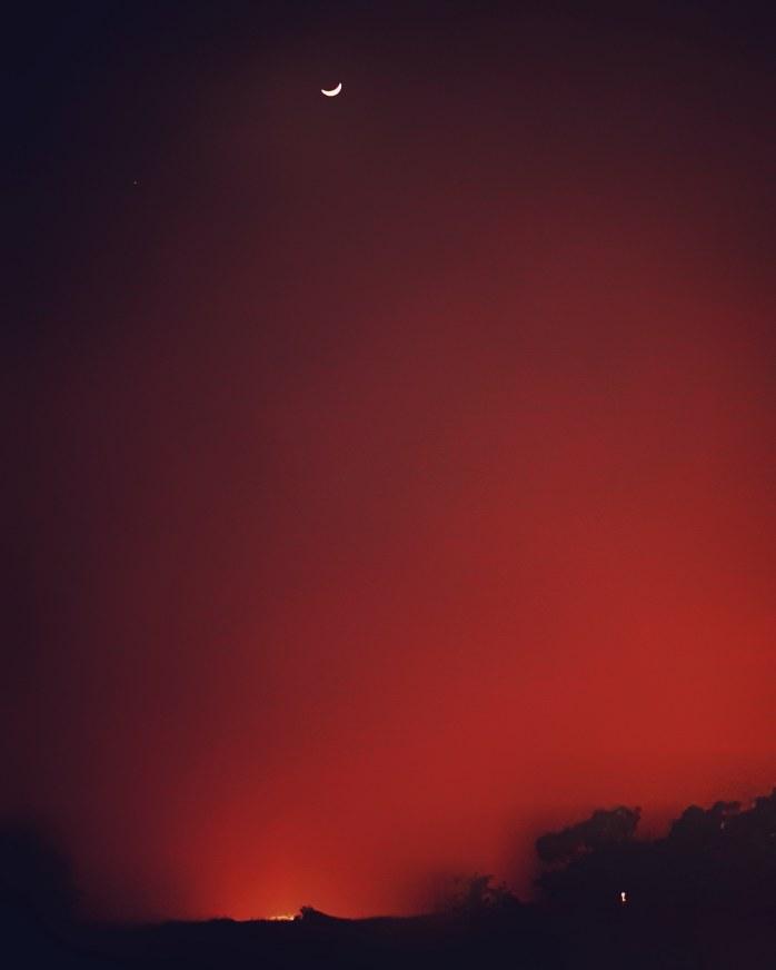 Dense fog, dramatic lights and crescent moon 🌒